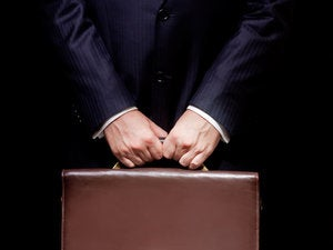 business person holding a briefcase 152121278