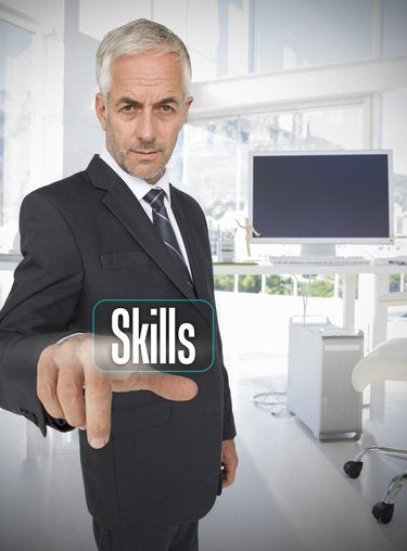 businessman selecting the word skills 175228552