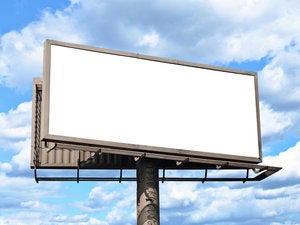 Blank billboard with sky and clouds in the background