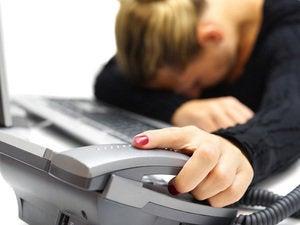 Woman asleep on telephone