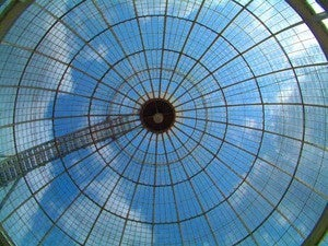 Looking up at the sky through a glass ceiling