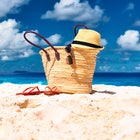 beach bag with hat and flip flops