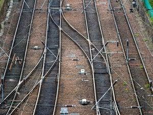 convergence railroad tracks merge paths