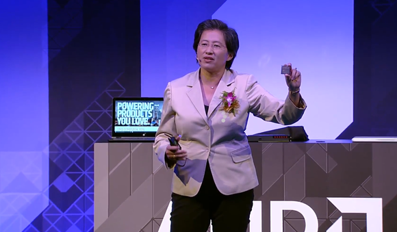 AMD CEO Lisa Su showing a Zen chip.